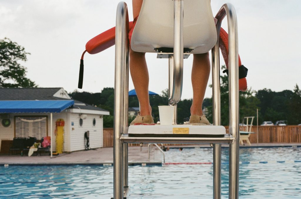 lifeguard by swimming pool